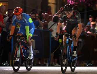 MARIO BARTEL/THE TRI-CITY NEWS Mitch Kettler, right, pips Florenz Knauer on the finish line to win the men's professional race at Friday's PoCo Grand Prix. The third annual race was the first in BC Superweek history to be held under the streetlights.