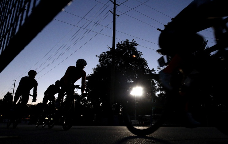 MARIO BARTEL/THE TRI-CITY NEWS The early laps of the pro men's race at the PoCo Grand Prix are held in dwindling twilight.