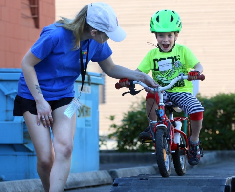 MARIO BARTEL/THE TRI-CITY NEWS The next generation of racers test their skills at the Kids Zone.