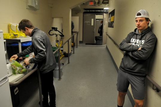 MARIO BARTEL/THE TRI-CITY NEWS Coquitlam Express forward Chase Danol waits as the team's trainer, Ross Maceluch, lays out some snacks prior to the team's midday game against the Langley Rivermen on Wednesday.