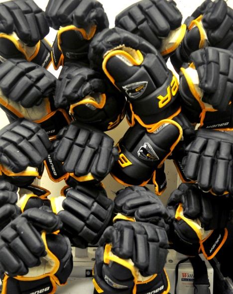 MARIO BARTEL/THE TRI-CITY NEWS Hockey gloves dry in a rack.