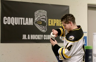 MARIO BARTEL/THE TRI-CITY NEWS Coquitlam Express forward Dallas Farrell gets his stick ready for Wednesday's game against the Langley Rivermen.