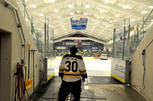 MARIO BARTEL/THE TRI-CITY NEWS Express starting goalie for the game, Kolby Matthews, takes a quiet moment prior to the team skating onto the ice.