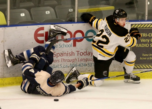 MARIO BARTEL/THE TRI-CITY NEWS Coquitlam Express forward Danny Pearson and Langley Rivermen defenceman Alec Capstick collide as they battle for a loose puck in the first period of their BC Hockey League game, Wednesday at the Poirier Sports and Leisure Complex.