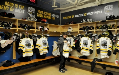 MARIO BARTEL/THE TRI-CITY NEWS Coquitlam Express trainer Ross Maceluch lays out uniforms and equipment for the players before their arrival for Wednesday's midday game against the Langley Rivermen.