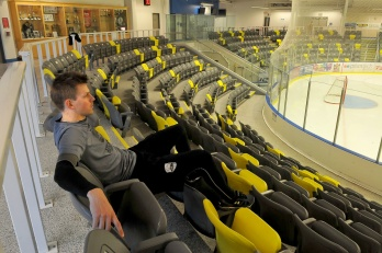 MARIO BARTEL/THE TRI-CITY NEWS Express forward Christian Sanda takes a quiet moment in the stands prior to the team's midday game against the Langley Rivermen on Wednesday. He said he uses the time to visualize the game ahead before he gets dressed to play.