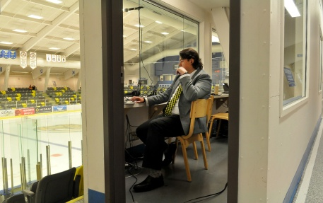 MARIO BARTEL/THE TRI-CITY NEWS Longtime Express broadcaster Eddie Gregory does some last-minute preparation in his booth at center ice. He's been with the team since it's first season.