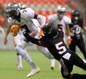 MARIO BARTEL/THE TRI-CITY NEWS New Westminster Hyacks wide receiver Ajay Choi tries to break the tackler of Terry Fox Ravens safety Kyle Huish in their BC Secondary Schools Football Association AAA Subway Bowl semi-final, Saturday at BC Place Stadium. New Westminster won the game, 33-0.