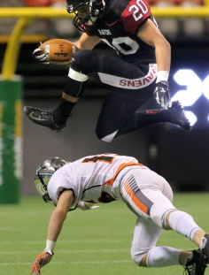 MARIO BARTEL/THE TRI-CITY NEWS Terry Fox Ravens full back Liam Cumarasamy leaps over a New Westminster Hyacks tackler in their BC Secondary Schools Football Association AAA Subway Bowl semi-final, Saturday at BC Place Stadium. New Westminster won the game, 33-0.