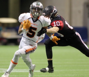 MARIO BARTEL/THE TRI-CITY NEWS New Westminster Hyacks ball carrier Broxx Comia slips the grasp of Terry Fox Ravens tackler Cade Cote in their BC Secondary Schools Football Association AAA Subway Bowl semi-final, Saturday at BC Place Stadium. New Westminster won the game, 33-0.