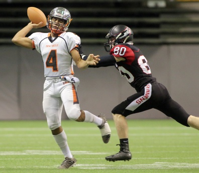 MARIO BARTEL/THE TRI-CITY NEWS New Westminster Hyacks quarterback Kinsale Phillip looks to throw the ball as he's caught by Terry Fox Ravens tackler Steven Jiang early in their BC Secondary Schools Football Association AAA Subway Bowl semi-final, Saturday at BC Place Stadium. New Westminster won the game, 33-0.