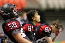 MARIO BARTEL/THE TRI-CITY NEWS The reaility of their 33-0 loss to the New Westminster Hyacks in Saturday's Subway Bowl AAA semi-final sinks in for Liam Stewart, Joshua Morris and Jake McEwan of the Terry Fox Ravens.