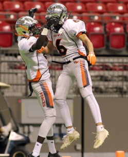 MARIO BARTEL/THE TRI-CITY NEWS New Westminster Hyacks wide receiver Matthew Lalim (#9) celebrates his touchdown with teammate Arjun Bal late in the team's 33-0 win over the Terry Fox Ravens in Saturday's BC Secondary Schools Football Association AAA Subway Bowl semi-final at BC Place Stadium.