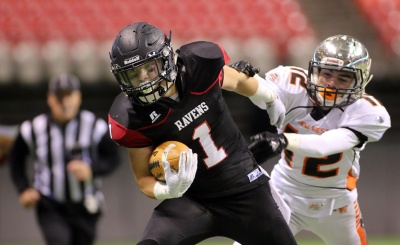 MARIO BARTEL/THE TRI-CITY NEWS Terry Fox Ravens running back Ethan Shuen tries to get away from New Westminster Hyacks tackler Greyson Planinsic in the second half of their BC Secondary Schools Football Association AAA Subway Bowl semi-final, Saturday at BC Place Stadium. New Westminster won the game, 33-0.