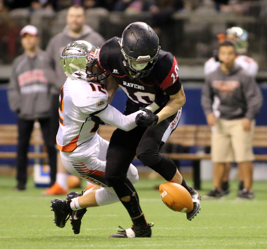 MARIO BARTEL/THE TRI-CITY NEWS Terry Fox Ravens running back Cade Cote fumbles the football as he's hit by New Westminster Hyacks tackler Greyson Planinsic late in their BC Secondary Schools Football Association AAA Subway Bowl semi-final, Saturday at BC Place Stadium. New Westminster won the game, 33-0.