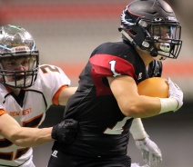 MARIO BARTEL/THE TRI-CITY NEWS Terry Fox Ravens running back Ethan Shuen is caught by a New Westminster Hyacks tackler in their BC Secondary Schools Football Association AAA Subway Bowl semi-final, Saturday at BC Place Stadium. New Westminster won the game, 33-0.