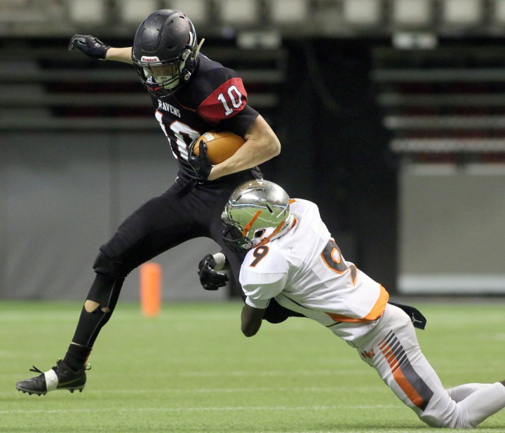 MARIO BARTEL/THE TRI-CITY NEWS Terry Fox Ravens running back Cade Cote can't escape the clutches of New Westminster Hyacks tackler Matthew Lalim in their BC Secondary Schools Football Association AAA Subway Bowl semi-final, Saturday at BC Place Stadium. New Westminster won the game, 33-0.