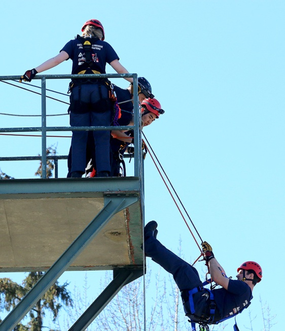MARIO BARTEL/THE TRI-CITY NEWS One of the junior firefighters prepares to rappel from the training tower.