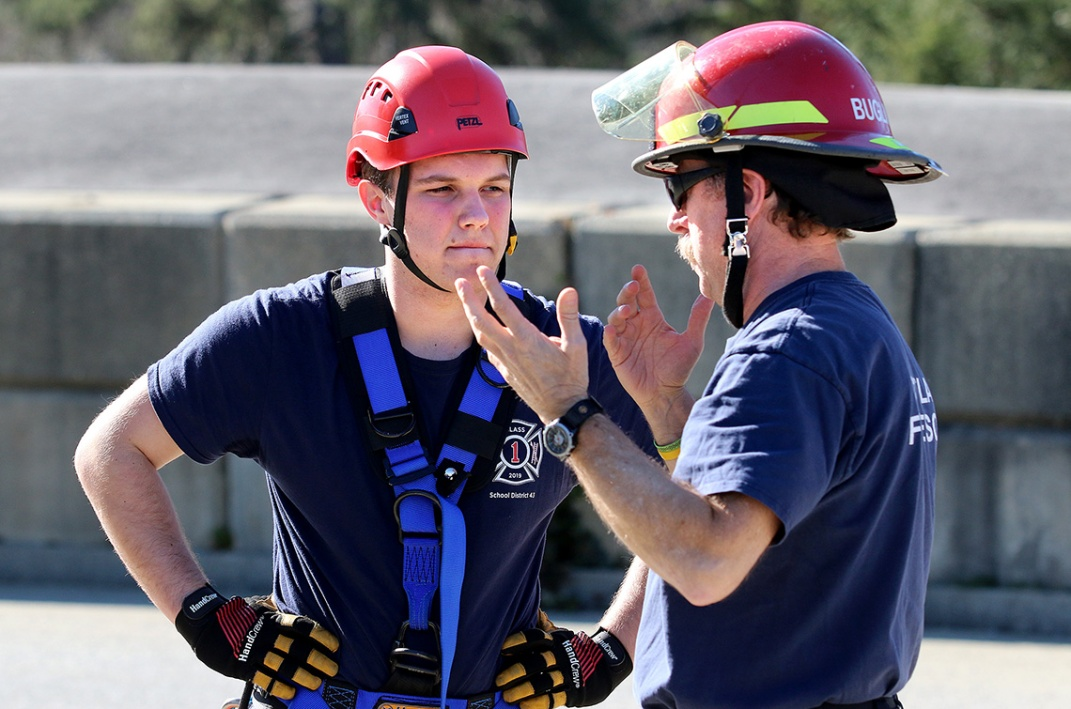 MARIO BARTEL/THE TRI-CITY NEWS Callum Borden gets debriefed after he reaches the ground.