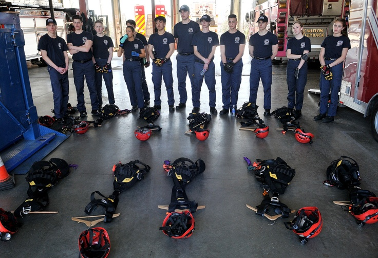 MARIO BARTEL/THE TRI-CITY NEWS The junior firefighters get introduced to the harnesses and equipment they'll wear during high angle rescue training.
