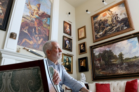 MARIO BARTEL/THE TRI-CITY NEWS Retired engineer Cosimo Geracitano has surrounded himself with paintings in his Coquitlam home by some of the world's great masters, including Da Vinci, Renoir, Van Gogh and John Constable. But he's not fabulously wealthy. He's meticulously painted the reproductions himself.