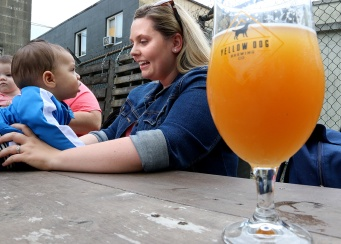 MARIO BARTEL/THE TRI-CITY NEWS Sarah Williams shares a moment with her son, Aiden, 8 months, during the monthly Tri-Cities Babies and Beer meet up group at Yellow Dog Brewing in Port Moody.