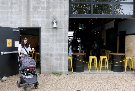 MARIO BARTEL/THE TRI-CITY NEWS Michelle Cochrane makes her arrival, with her five-month-old son, Grayson, at the monthly gathering moms and their babies at Yellow Dog Brewing in Port Moody.