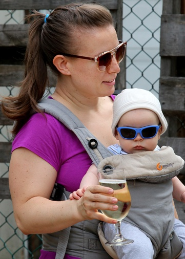 MARIO BARTEL/THE TRI-CITY NEWS Chrystal Santos stays cool with a cider while her son, Callum, who's four-months-old, stays cool with stylin' sunglasses.