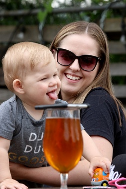MARIO BARTEL/THE TRI-CITY NEWS Ty Hardless, 11 months, appears to be savouring a beer next to his mom, Sandy.
