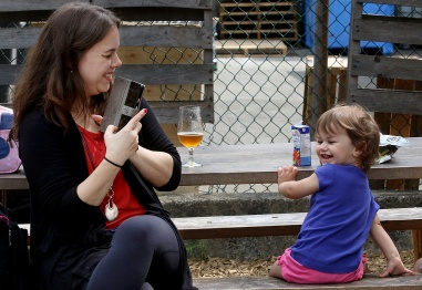 MARIO BARTEL/THE TRI-CITY NEWS Fernanda Carli shares a giggle with her two-year-old daughter, Carli.