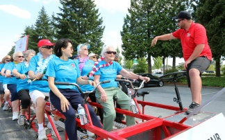 MARIO BARTEL/THE TRI-CITY NEWS Big Bike driver Phil Reist gives the cyclists from Mayfair Terrace retirement home their instructions to stay safe and have fun.