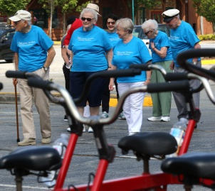 "MARIO BARTEL/THE TRI-CITY NEWS The seniors from Mayfair retirement home in Port Coquitlam arrive to ride the Heart and Stroke Foundation's ""Big Bike"" on roads around Coquitlam Centre last Friday."