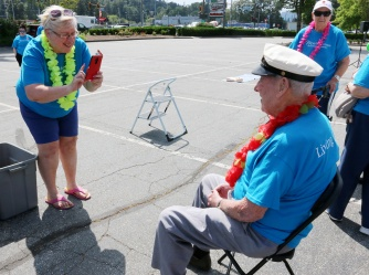 MARIO BARTEL/THE TRI-CITY NEWS Simpson gets his photo taken prior to climbing aboard the big bike as captain of a team of seniors from Mayfair retirement home in Port Coquitlam.