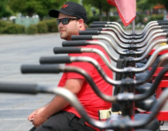 MARIO BARTEL/THE TRI-CITY NEWS The big bike's pilot, Phil Reist, awaits his charges from Mayfair Terrace retirement home.