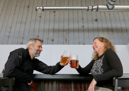 MARIO BARTEL/THE TRI-CITY NEWS Andrea MacIntosh and Phil Smith toast their new Port Coquitlam craft brewery, Tinhouse Brewing, which opens this weekend.