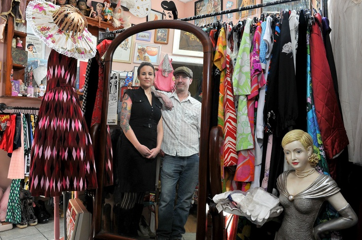 """MARIO BARTEL/THE TRI-CITY NEWS Heather Wallace-Barnes and her husband, Johnny Barnes, check out the """"ladies room,"""" one of the themed rooms in their Pinball Alley Vintage shop in Port Moody that sells clothes and all manner of curios from the 1950s, '60s and '70s, as well as old vinyl records. They're selling the shop to move their family to Spain. Generally, I'm dismayed by mirrors. But I love the challenge of integrating them into my photos. You just have to be careful with your positioning so you don't end up in the photo, and then think about everything else — like lighting and composition — backwards."""