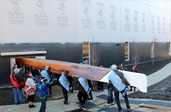 MARIO BARTEL/THE TRI-CITY NEWS The canoe is carried into the gymnasium at the Kwikwetlem First Nation's Healing Spirit Centre. It's not everyday you get to photography a giant, 30-foot canoe, so it was important to somehow capture the effort it takes to move such a behemoth into the new First Nation's Healing Spirit Centre.