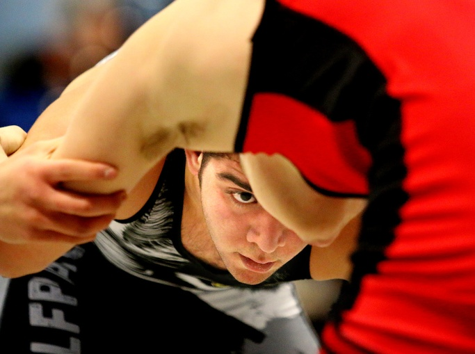MARIO BARTEL/THE TRI-CITY NEWS Heritage Woods' Karosh Rafizadeh keeps a close eye on his opponent, Aiden Winterlik, from Terry Fox, in their 66kg match at the Lower Fraser Valley district wrestling championships, last Friday at Port Moody secondary school. I won't sugarcoat it: wrestling is a tough sport to shoot, made even more difficult by the often dismal lighting in high school gyms. That means you usually have to use a slower shutter speed and higher ISO than you'd like, or wait for a quiet moment of intensity like this.