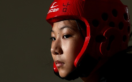MARIO BARTEL/THE TRI-CITY NEWS Jade Lee cried when she first started competing in Tae Kwon Do. Now she's a Canadian junior champion. Suburban living rooms usually don't make for the best photo studios. So that's when you simplify by setting up a single light and zooming in.