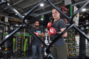 MARIO BARTEL/THE TRI-CITY NEWS Port Moody's Julia Budd is about to be joined on the Bellator MMA circuit by her stepson, Lance Gibson Jr. Budd will be defending her featherweight world championship in July. MMA fighters do their thing in a caged arena, so of course that chainlink cage has to feature prominently in telling their story.