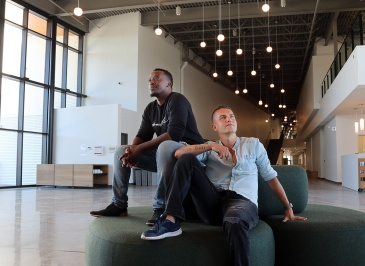 MARIO BARTEL/THE TRI-CIY NEWS Mandela Nsenga, the youth pastor at the new Riverside Church in Port Coquitlam, relaxes in the atrium with associate pastor Dave Jonsson. A story about a giant new church building in Port Coquitlam is really a story about the congregation staying relevant and contemporary.