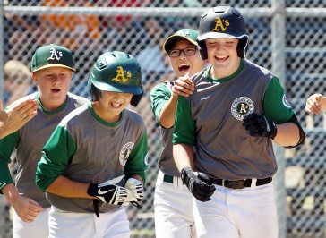 MARIO BARTEL/THE TRI-CITY NEWS Coquitlam's Matthew Shanley, right, celebrates his seventh homerun wiith his teammates at the BC Little League Majors provincial championship tournament, Friday at Vancouver's Hillcrest Park. Coquitlam defeated Layritz, 7-6, in eight innings. Heading into Vancouver to cover the local Little League team at the provincial championships, who knew this would be the start of a magnificent journey to the World Series for these kids.