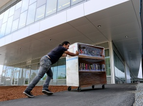 MARIO BARTEL/THE TRI-CITY NEWS Workers move the Terry Fox Library's collection of more than 260,000 items into its new home at the new Port Coquitlam Community Centre next door on Tuesday. The move took two days and, the librarian's manager, Kimberly Constable, said, everything will be in place, along with several new items and features, in time for the community centre's grand opening on Tuesday, Aug. 27, at 4 p.m. It's not often a local library moves into a new facility. And when that move is just a short walk away, the toil of that move can make an interesting photo.