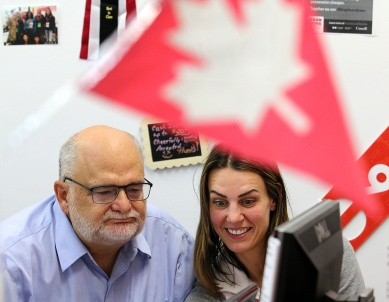 MARIO BARTEL/THE TRI-CITY NEWS The Liberal MP for Coquitlam-Port Coquitlam, Ron McKinnon, watches election night results come in with one of his campaign volunteers, Haley Hodgson. For all the buildup to covering election nights, they're usually a visual let-down. The celebration parties are usually in dark, crowded halls, restaurants or pubs with lots of hugging and handshaking. So when Liberal MP Ron McKinnon decided to spend a little more time at his nearby campaign office to monitor the incoming results, I asked if I could tag along.