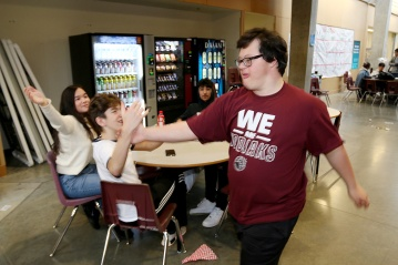 MARIO BARTEL/THE TRI-CITY NEWS Reid Demelo accepts the high-fives of other students at Heritage Woods secondary school in Port Moody after his three-point shot at the buzzer of last Thursday's Kodiak Klassic senior boys basketball tournament game between the Kodiaks and Kitsilano secondary went viral on the Internet. Principal Tood Clerkson said everyone in the school knows Demelo, who has Down's Syndrome, and his moment of glory is testimony to the student's sense of acceptance and inclusion. AS soon as I walked into Heritage Woods secondary to meet Reid Demelo for an interview about his sudden social media celebrity, I spotted the parting wave of well-wishers and high-fiving friends ahead of me and the enthusiasm never let up as we headed for the main office to extend our chat to the school's principal.