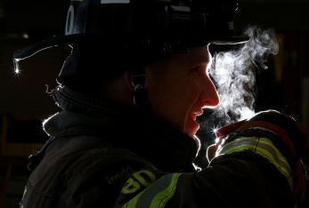MARIO BARTEL/THE TRI-CITY NEWS Port Moody firefighters like Jeff Scallion will be serving up steaming mugs of coffee and hot chocolate at their annual tree chipping event on Sat., Jan. 4, and Sun., Jan. 5, from 9 a.m. to 4 p.m., at the Inlet Centre fire hall (150 Newport Dr.). For this photo, I wanted to play on the firefighters serving hot chocolate at their tree chipping event, so I blasted a flash set at full power from behind the firefighter to create a silhouette and highlight the steam from his mug.