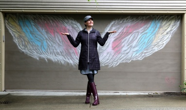 "MARIO BARTEL/THE TRI-CITY NEWS Ladawne Shelstad poses with one of her first ""interactive"" chalk murals she's created for garage doors in her Klahanie neighbourhood in Port Moody to help brighten spirit during the COVID-19 lockdown."