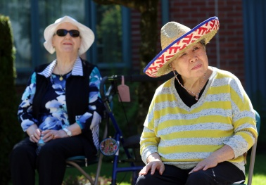 The bright sunshine means hats are the order of the day for seniors at Parkwood Manor. Photograph By MARIO BARTEL/THE TRI-CITY NEWS