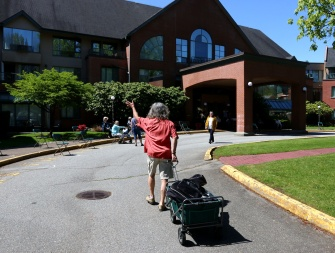 Chris Ridout waves to his fans and friends as he arrives to conduct a sing-a-long and yoga at Coquitlam's Parkwood Manor. Photograph By MARIO BARTEL/THE TRI-CITY NEWS