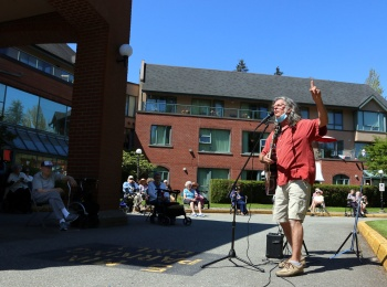 Chris Ridout teaches yoga and conducts a sing-a-long at Parkwood Manor in Coquitlam last Thursday. Photograph By MARIO BARTEL/THE TRI-CITY NEWS